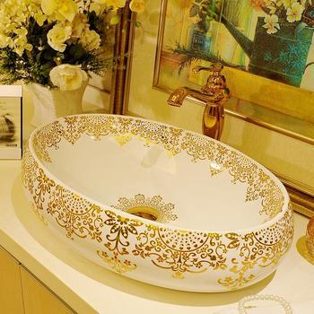 Ze złotym wzorem duży owalny umywalka umywalka Jingdezhen ceramiczna umywalka w stylu art deco umywalki blat umywalki łazienkowe tanie i dobre opinie JINGYILE Prostokątne Szampon umywalki Ręcznie malowane Ociekaczem Jeden otwór as show picture porcelain L600*W420*H150mm