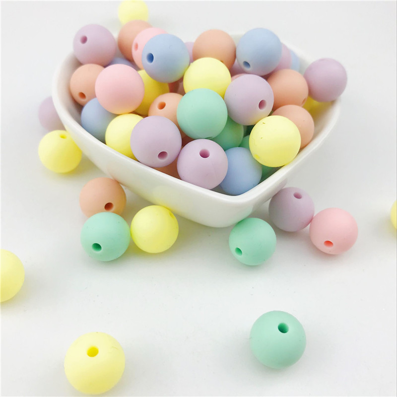 100pcs 12 20mm Baby Round Candy Color Silicone Teether Beads Infant Necklace Pendant DIY Chew Nursing Accessories in Baby Teethers from Mother Kids