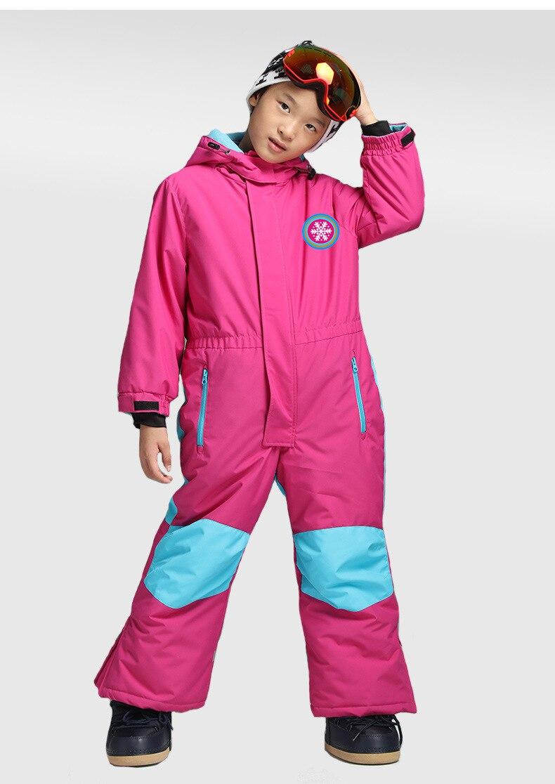 Купить с кэшбэком 2018 new children's one-piece ski suit solid color warm hooded ski suit