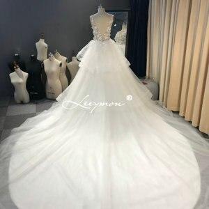 Image 4 - Leeymon งาช้างชุดแต่งงานเซ็กซี่ Illusion Top ไข่มุกชุดลูกยาวแขนกุดแต่งงานชุดเจ้าสาว Robe de mariee