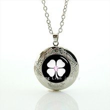 Attractive trendy irish Four Leaf Clover picture Glass Cabochon Dome locket necklace with black backgroud best gift for friends(China)