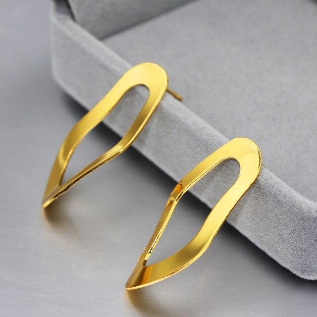 Женские асимметричные серьги гвоздики just feel большие золотого