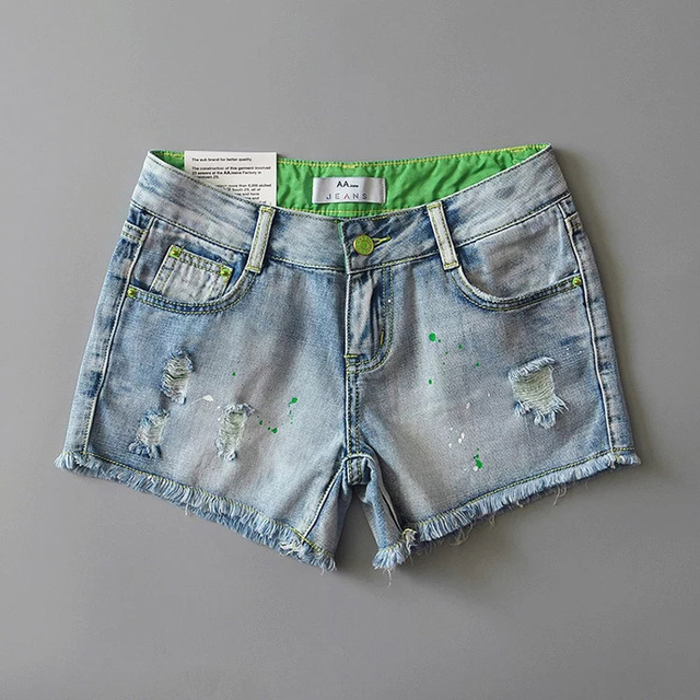 Autumn winter in Europe and the United States the wind in the waist hole paint spray hit the color of hair denim shorts wild sho
