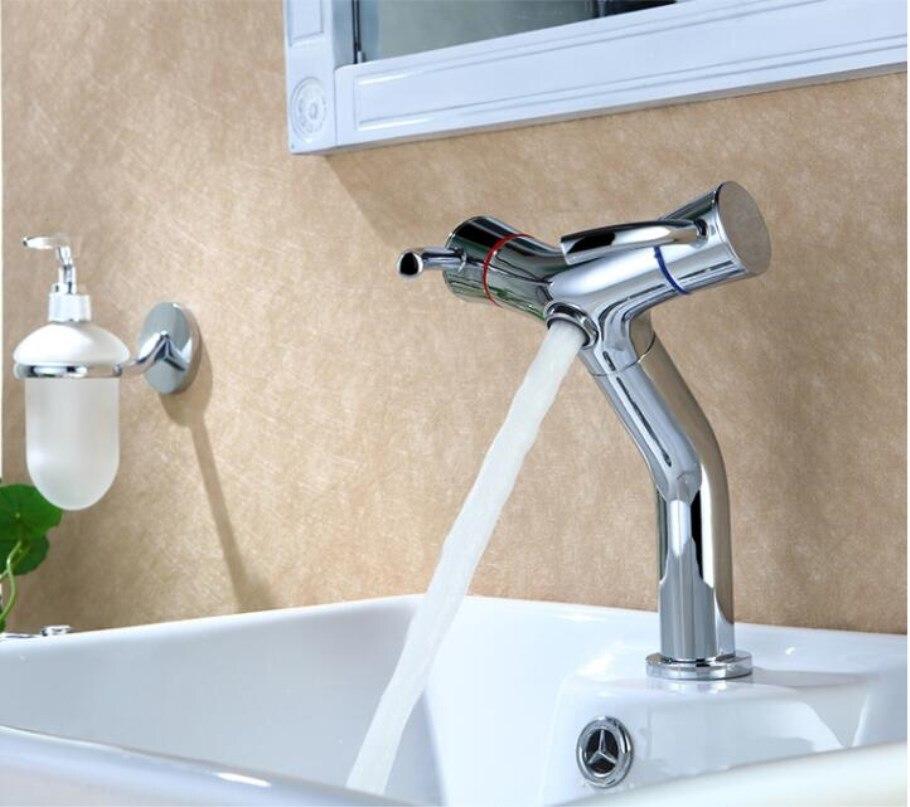 Здесь можно купить  chrome brass unique design bathroom hot and cold  sink faucet basin faucet lavatory tap  Строительство и Недвижимость