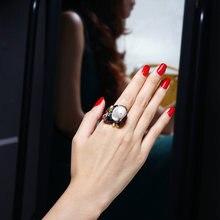 Кольцо с натуральным жемчугом черное кольцо красным фианитом