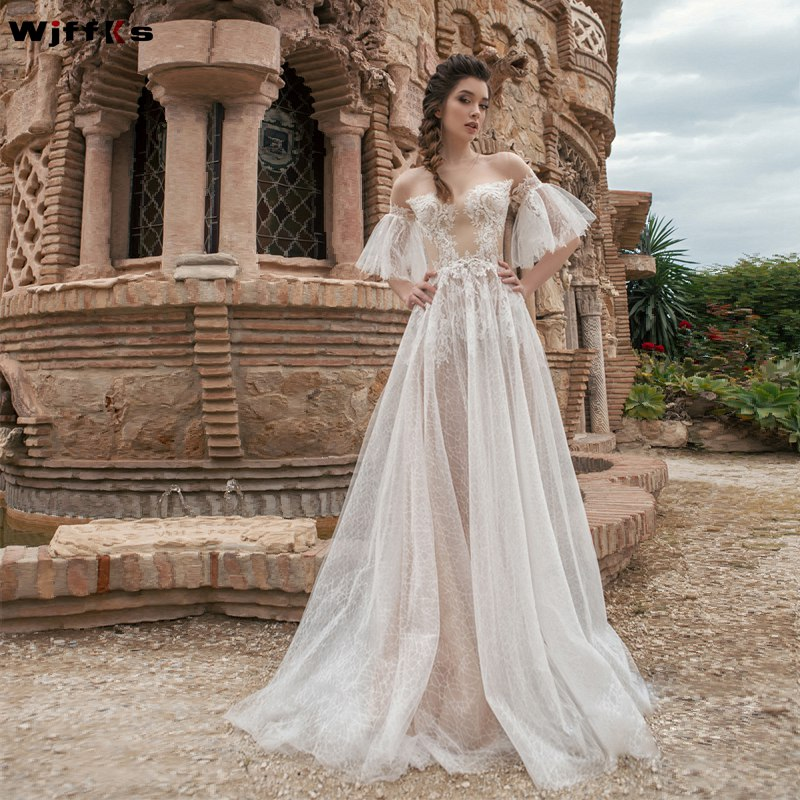 Image 2 - WJFFKS 2019 New Jewel Neck Sheer Half Long Sleeves A Line  Wedding Dresses Illusion Back with Buttons Long Bridal Gowns-in Wedding Dresses from Weddings & Events