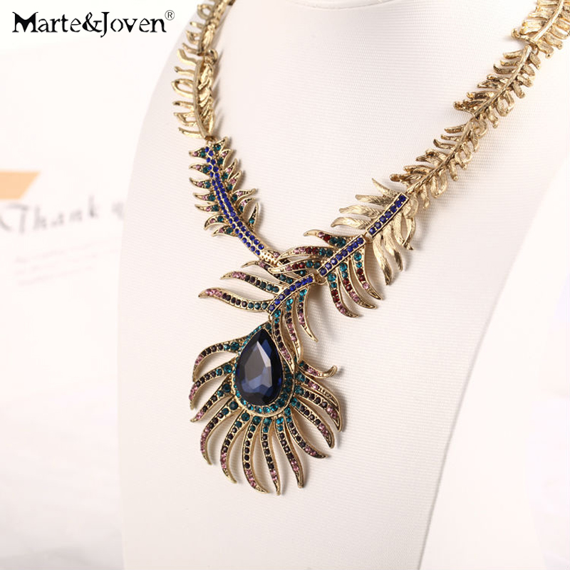 Marte&Joven Hyperbole Crystal Peacock Feather Bib Statement Choker for Women Blue Stone Vintage Chunky Collar Necklace