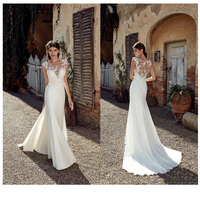Sleeveless See Through Neck Appliqued Lace Wedding Dresses 2019 Mermaid Train Illusion bridal gown dress White Ivory
