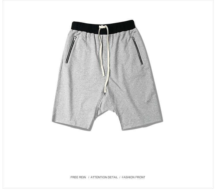 8cb7b3ac ... Men harem shorts hiphop kanye west justin bieber style short sweatpants elastic  waist zipper pockets man