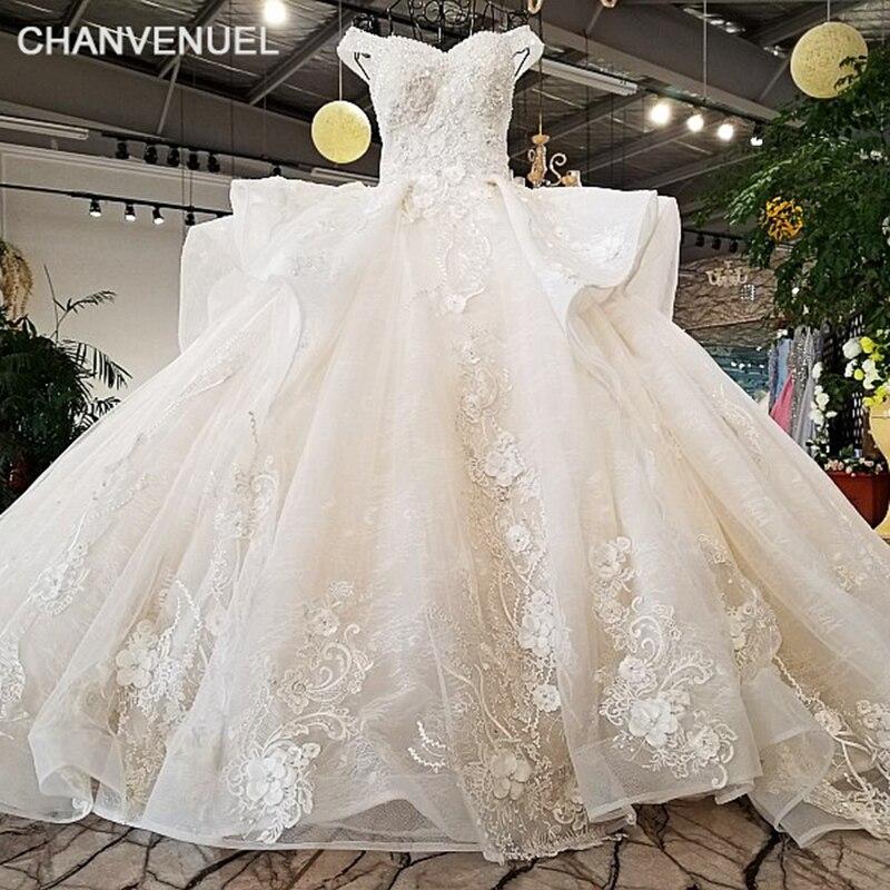 LS27210 colore bianco 100% vero spettacolo super puffy abito da sposa fiori 3D white lace sweetheart neck senza maniche 2018 abito da sposa