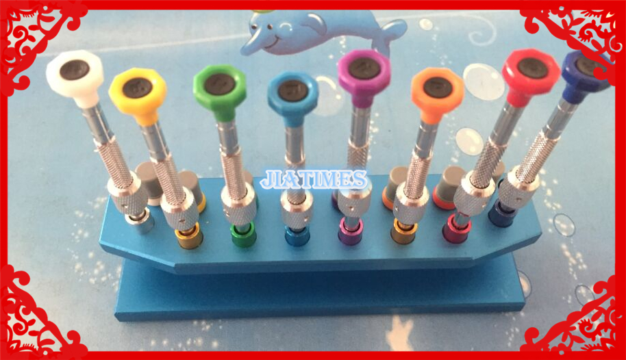 New 8pcs High Quality Metal Watch Screwdriver Set with Screwdriver Booster Comes in a Metal Stand
