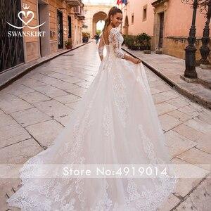 Image 2 - Sexy V hals Applicaties Wedding Dress Swanskirt Half Sleeve Lace Up A lijn Hof Trein Prinses Bruidsjurk Robe De Mariage LZ10