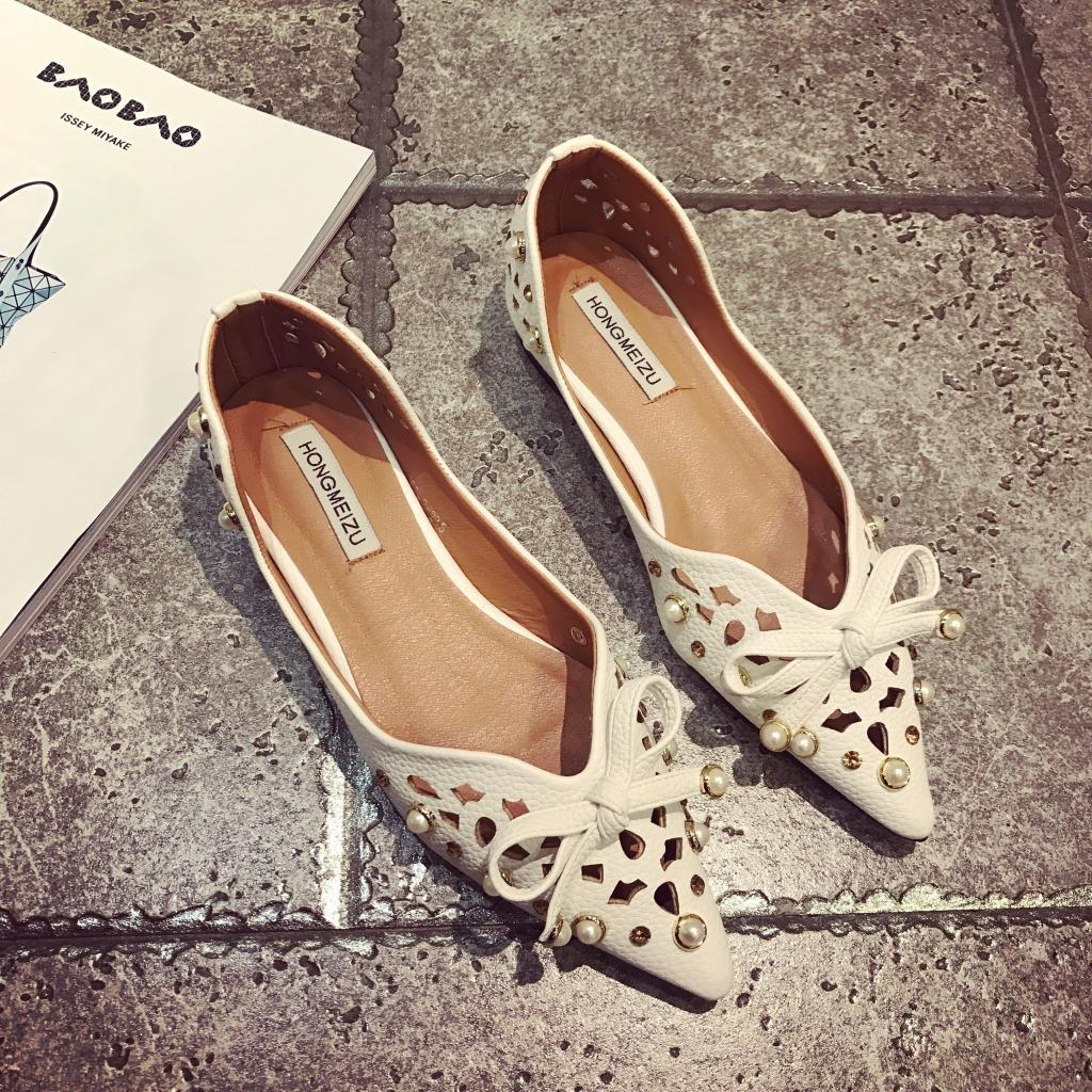 Cutout single shoes female 2017 spring and summer flat heel foot wrapping pointed toe pearl shallow mouth bow flat