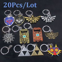 SG 20Pcs Lot Zelda Keychains Master Sword Triforce Hylian Shield Majora Mask Breath Wild Eye Pendants Keyring Men Jewelry Gift