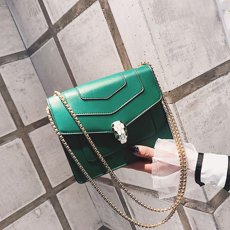 The same paragraph retro snake head female bag wild chain small party package mini simple shoulder portable Messenger bag. 2018 new female bag mini camera bag summer small square package korean version of the wild shoulder messenger bag