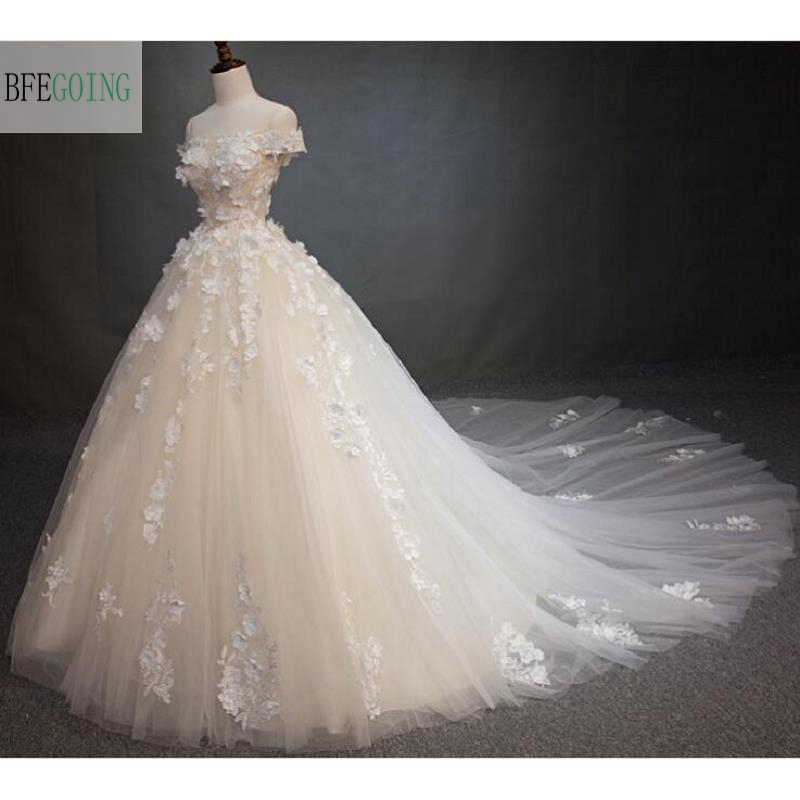 Cathedral Length Train Wedding Gowns: Strapless Appliques Tulle Floor Length A Line Wedding