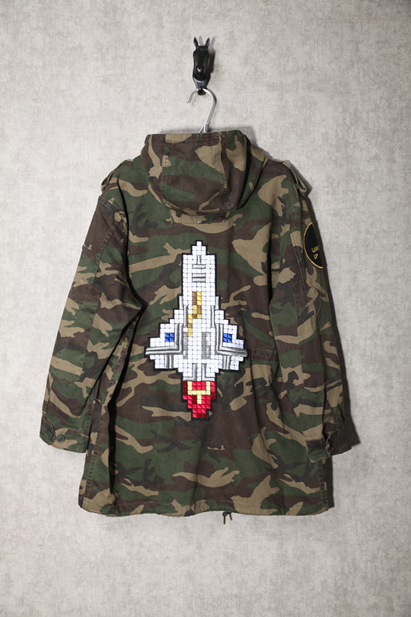 99269abb8fdbd 16ss fashion embroider outerspace rocket badges camo long hood trench jacket  men and women camouflage windbreaker-in Jackets from Men's Clothing on ...
