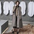 2016 feamle otoño nueva llegada diseño original de moda vintage diseño largo sin mangas de la capa de foso