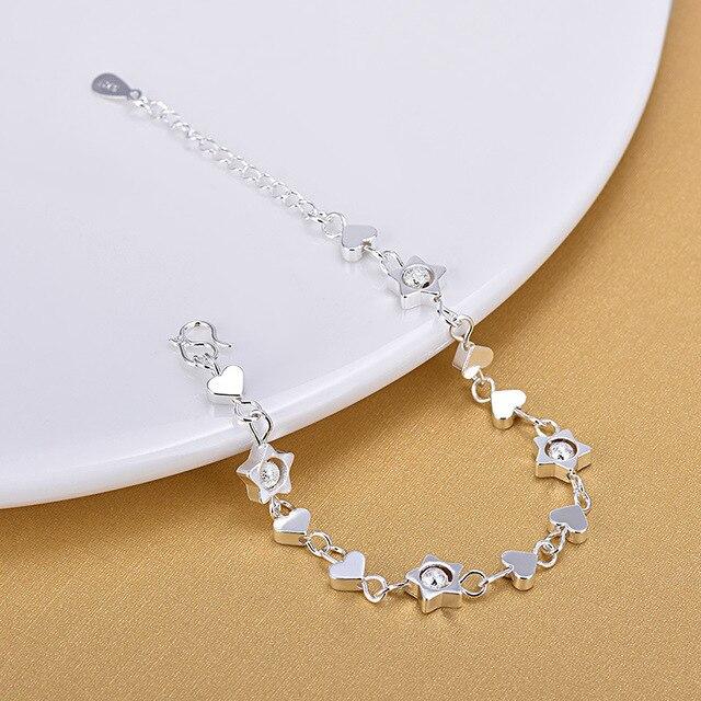 Фото женский браслет из серебра 925 пробы с шармами в виде сердца