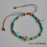 Lotus Mann màu xanh ngọc lấp lánh Tiger Eye Tiger eye đá mạ vàng nhỏ loạt vòng tay dành cho nam giới và phụ n
