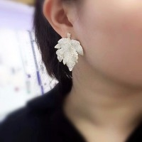 Qi Xuan_Trendy Jewelry_New Maple Leaf Earrings S925 Silver Inlay Zircon Elegant And Irregular Irregular_Factory Direct Sales