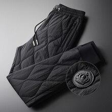 Męskie spodnie zimowe Minglu luksusowe dodaj wyściółkę grube utrzymuj ciepłe spodnie męskie Plus rozmiar 4xl moda w pasie jesienne męskie spodnie