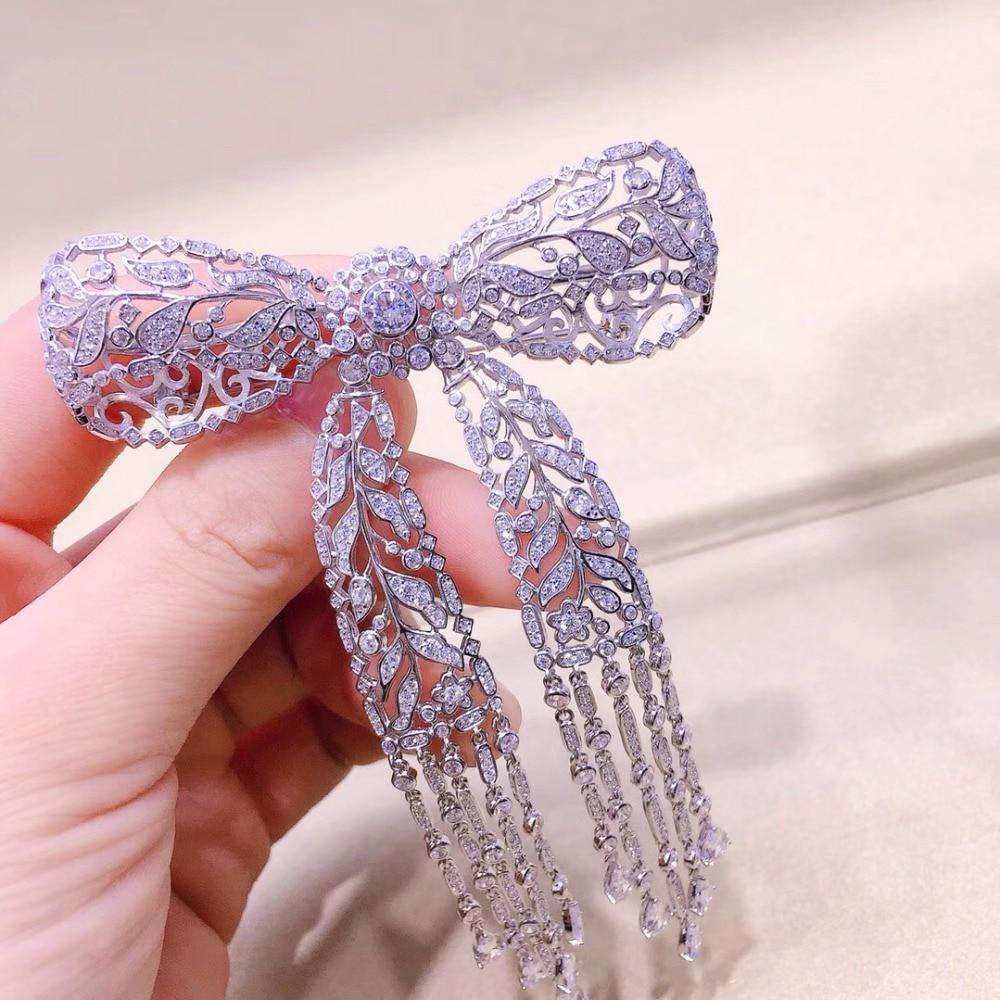 Qi Xuan_New S925 Sterling Silver Bowknot Tassel Brooch Brooch Pin Korea Luxury Atmosphere Brooch High End Women