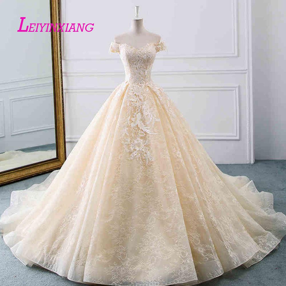 LEIYINXIANG New Arrival Wedding Dress Vestido De Noiva Robe de Mariee Modern Sexy Ball Gown Style Appliques Backless