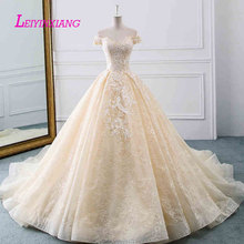 LEIYINXIANG New Arrival Wedding Dress Vestido De Noiva Robe de Mariee Modern Sexy Ball Gown Style Appliques Backless