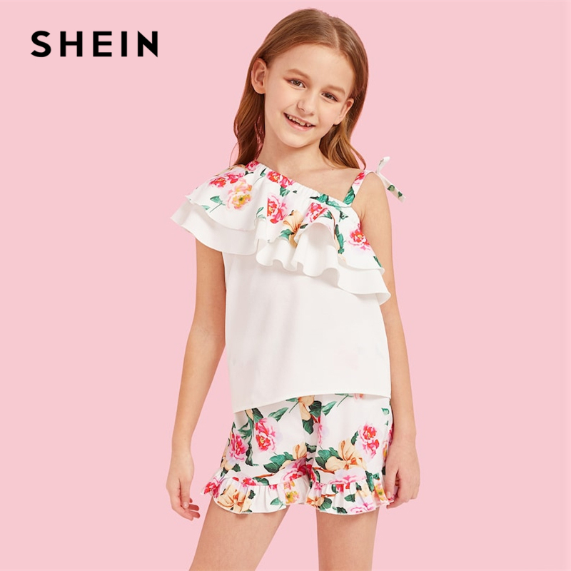 SHEIN Kiddie White Asymmetric Neck Floral Print Ruffle Top And Shorts Beach Set 2019 Summer Vacation Tiered Layer Two Piece Sets цена 2017