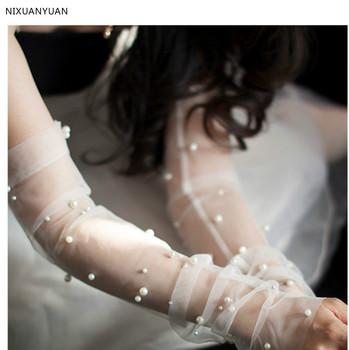 Tulle długie rękawiczki ślubne z perły ślubne z kości słoniowej rękawice tanie akcesoria ślubne wysokiej jakości rękawiczki ślubne tanie i dobre opinie WOMEN POLIESTER Opera Bez palców Dla osób dorosłych Jeden rozmiar 712-2100 Z paciorkami NIXUANYUAN