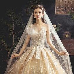 الصيف الحوامل فستان رومانسية الشمبانيا حمالة زهرة طويلة الدانتيل فستان حمل أنيق ذيل صغير فستان الحمل