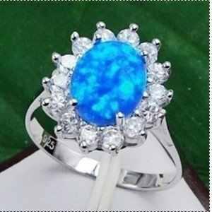 อัญมณีที่หายากสีฟ้าโอปอลไฟแหวนเงินขนาด7-9 4.28