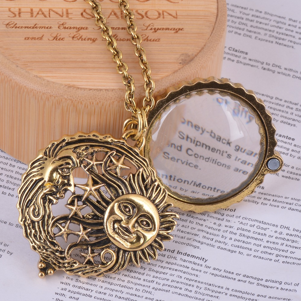 magnifier glass pendant sun with moon and stars collana antica gioielleria in oro si apre e si chiude