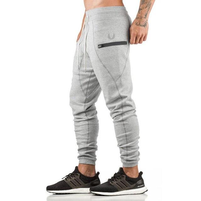 13ca25421b8b2 Novos Homens do algodão Moletom 2018 Primavera outono estilo Academias de  fitness moda Casual calças slim
