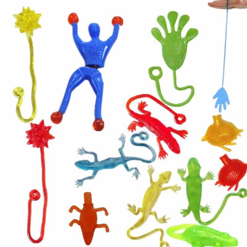 1 piece 9cm 3cm Silica gel robot Climbing Spider Man sticky Spiderma Superman Climbing on glass