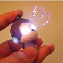 HOT sale Kawaii LED Flashlight Monkey Keychains Action Figure Toys With Sound Bags Accessories free shipping