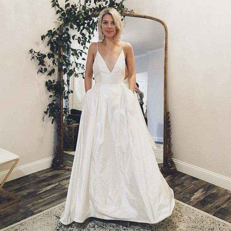 Bretelles Spaghetti col en V Satin blanc robes de bal avec poches robes de mariée modernes