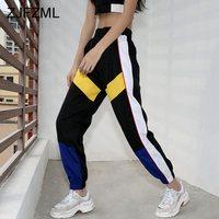 Яркие брюки в спортивном стиле
