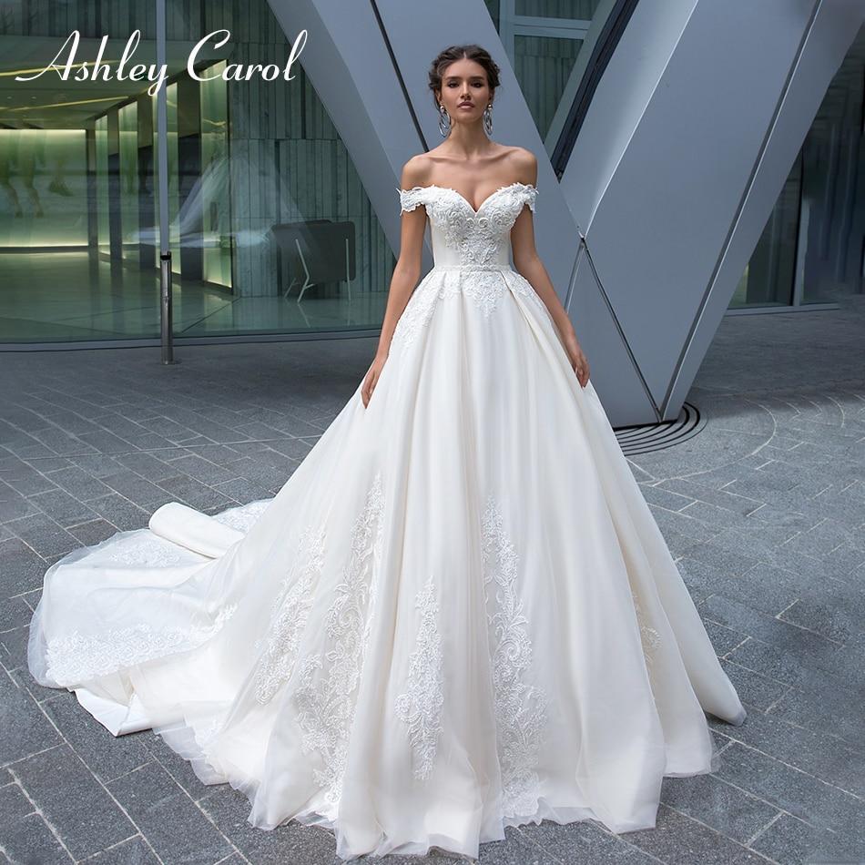 Ashley Carol Sexy Sweetheart Cap Sleeve Backless Wedding Dress 2019 New Luxury Beaded Sashes Court Train