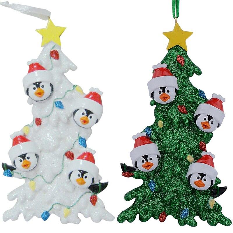 Familia de pingüinos de resina de 4 adornos navideños con árbol - Para fiestas y celebraciones
