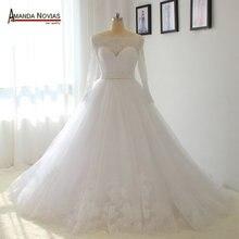 فستان زفاف مرصع باللؤلؤ بأكمام مكشوفة الأكتاف لون أبيض لطلب العميل 2018