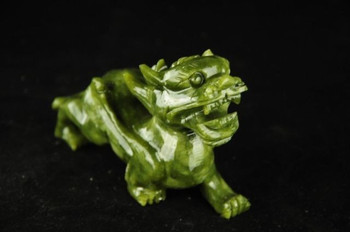 Chinese jade carving a kirin fu feng shui to ward off bad luck dog statues.