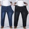 Masculino super grande tamanho das calças de brim elásticas moda simples obesos calças jeans retas meados de cintura casuais comprimento total para os homens