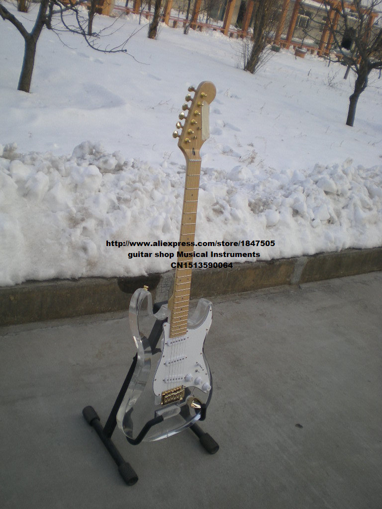 new single electric guitar with organic glass body made in China free shipping (according to request custom color) free shipping retail new electric bass guitar body in natural color foam box