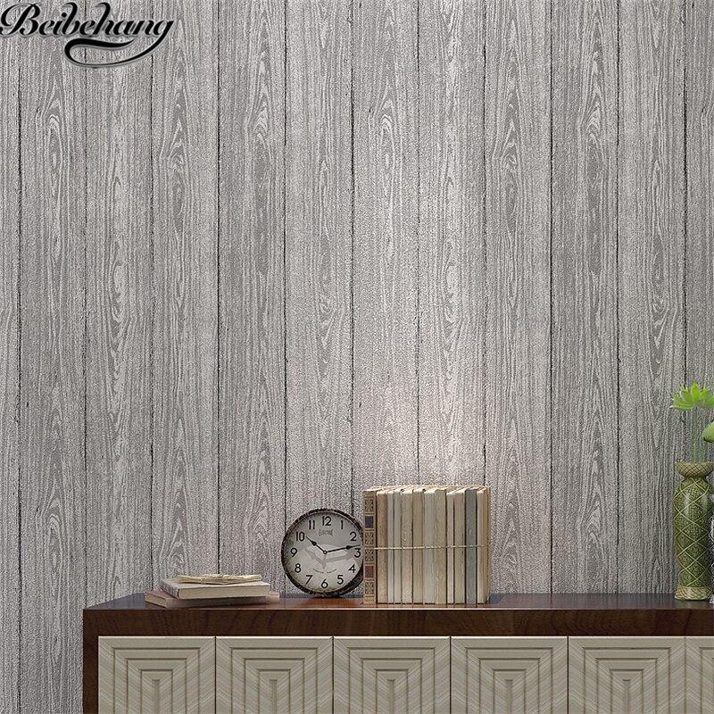 Beibehang papier peint couleur unie plaine bois planche grain de bois 3D pression non-tissé papier peint chambre salon TV papier peint