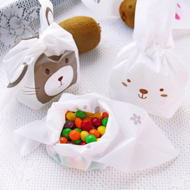 Online shop tronzo 50pcs easter bunny cookies bag wedding favors tronzo 50pcs easter bunny cookies bag wedding favors and gifts cute rabbit ear plastic candy gift bag birthday party supplies negle Images