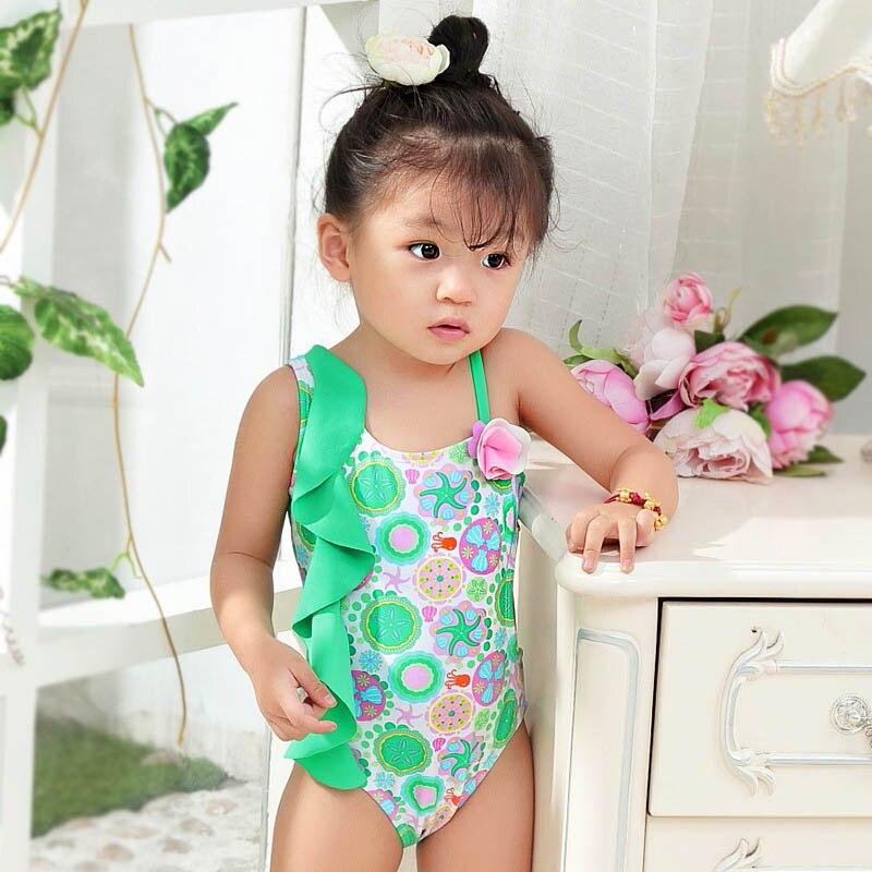 2017 nuovi bambini costumi da bagno bambini bambino verde spalle diagonali scavato fiori ragazze siamesi nuoto