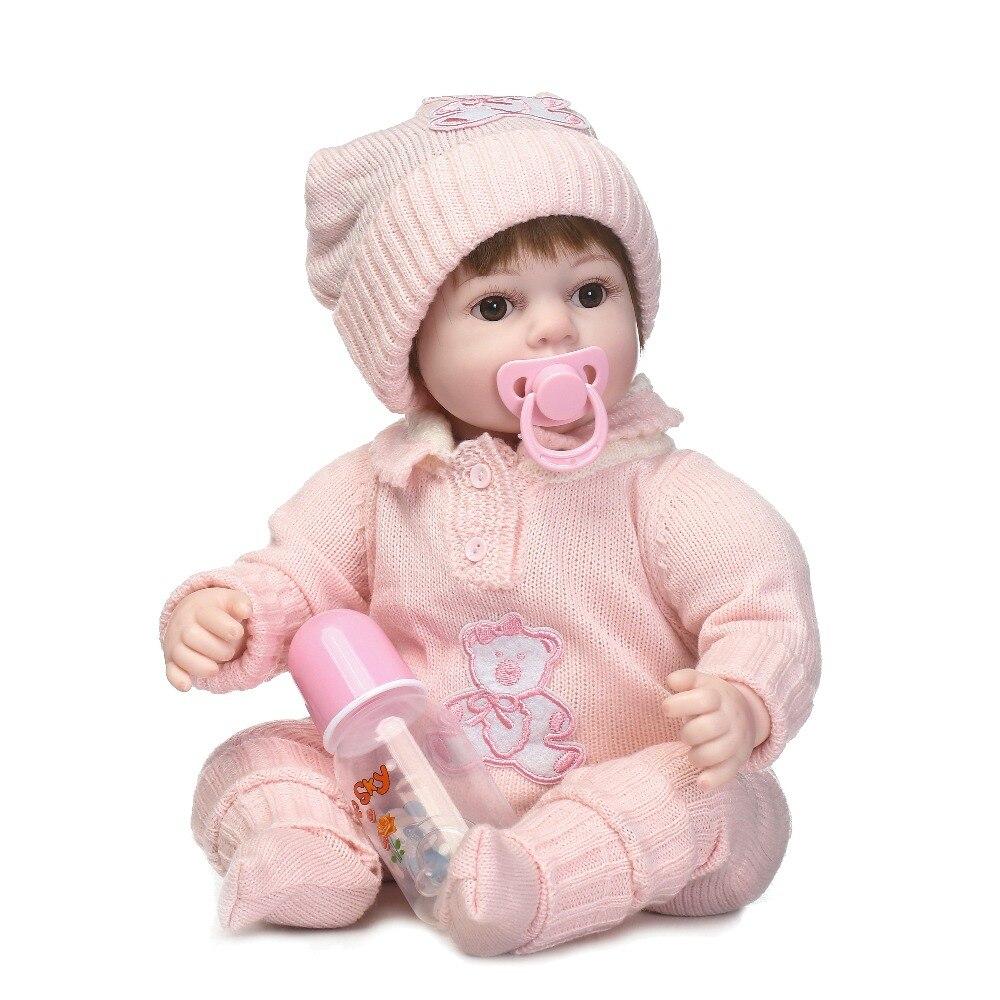 NPKCOLLECTION belle reborn bébé poupée en rose pull vinyle silicone doux réel doux toucher cadeau pour les enfants le jour de l'anniversaire