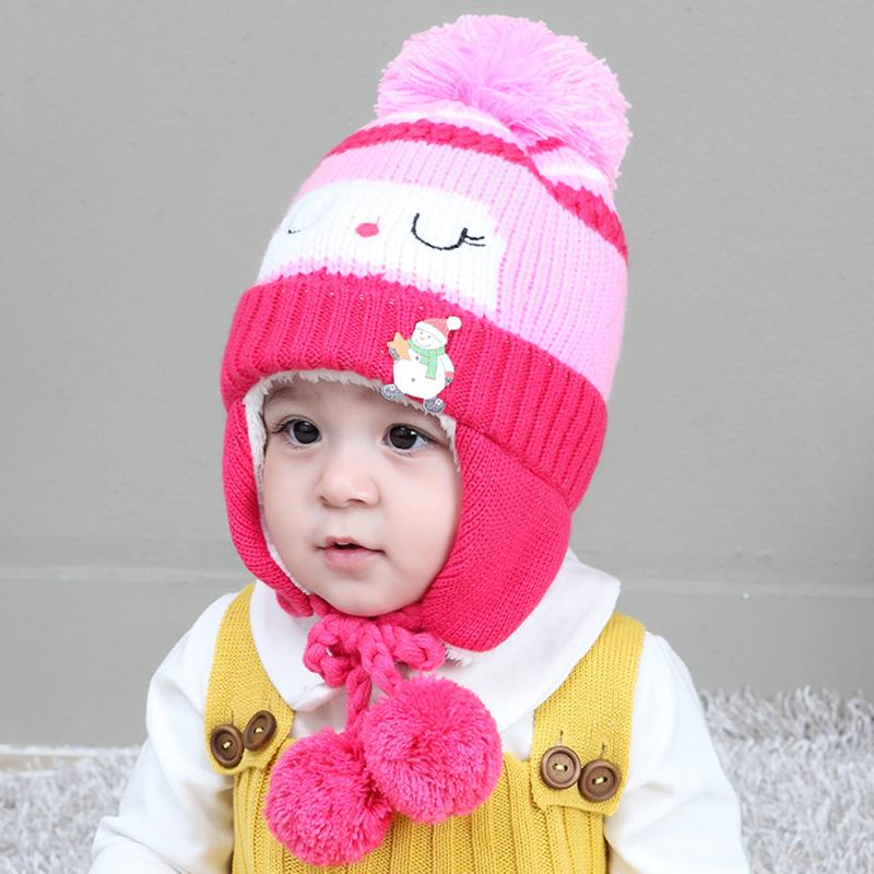 6a1bce10350 Lovely Snowman Pattern Baby Winter Warm Hat with Cute Hair Balls Thicken  Wool Knitting Boys Girls Earflap Cap Mixed Color Hat